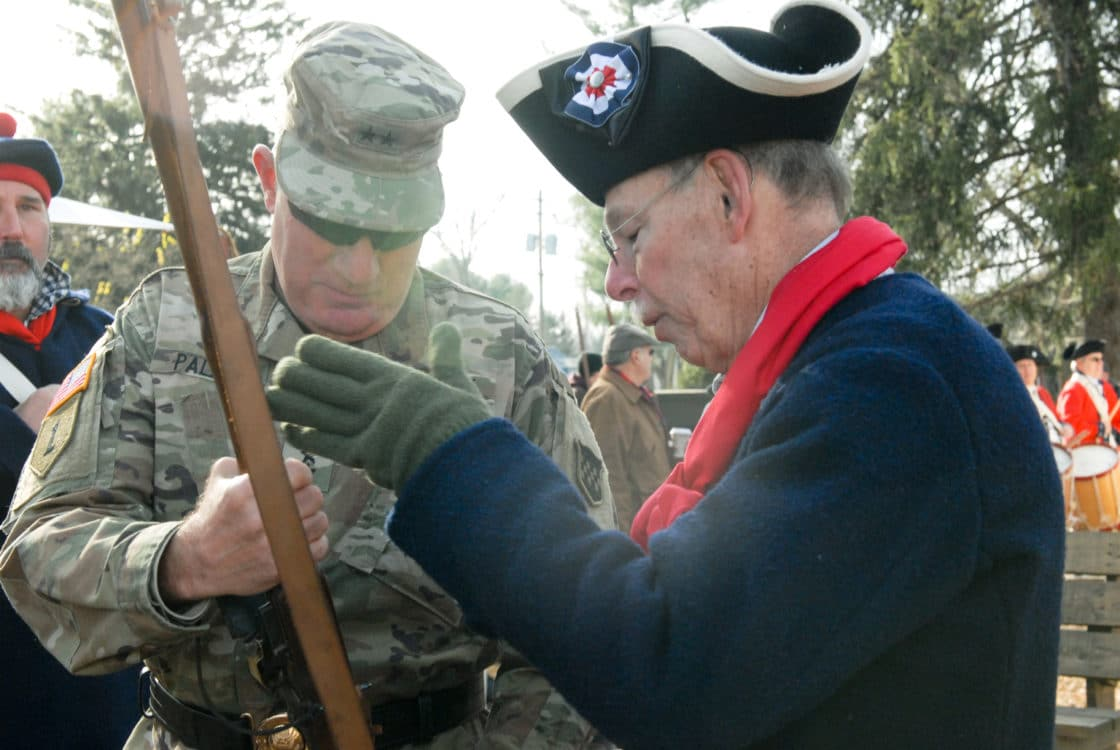 Maj. Gen. Mark Palzer, commanding general of the U.S. Army Reserve's 99th Readiness Division (left), prepares to fire a musket with help from Army Reserve Ambassador Larry Rubini during the 67th annual re-enactment of Gen. George Washington crossing the Delaware River Dec.8 at Washington Crossing Historic Park in Washington Crossing, Pennsylvania. This event commemorates Washington's actual crossing Dec. 25-26, 1776, when he led several thousand troops across the icy river to conduct a surprise attack on enemy forces in Trenton.
