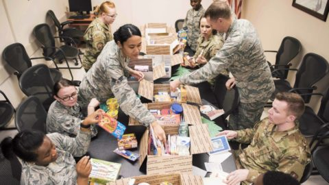 care packages for troops being opened